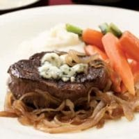 filet mignon with caramelized onions and gorgonzola
