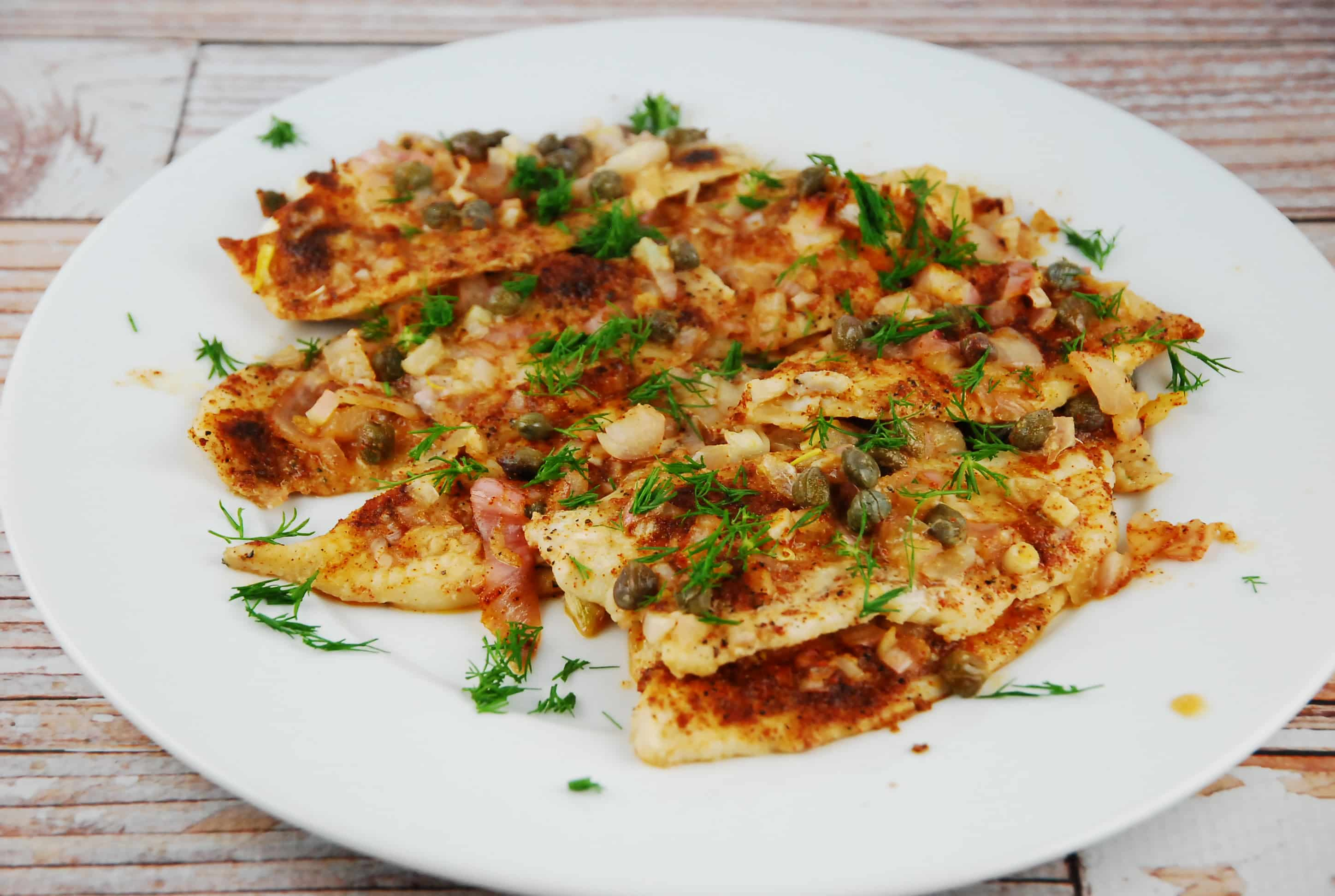 Mediterranean baked tilapia recipe 3 smart points laaloosh for Fish seasoning for tilapia